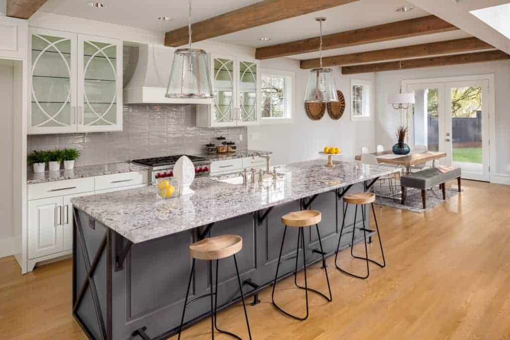 Beautiful marble counter kitchen with large island in middle
